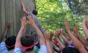 Students climb wall