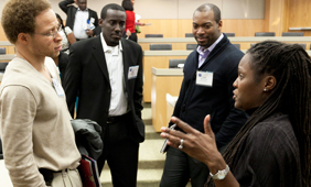 Students speaking with professor