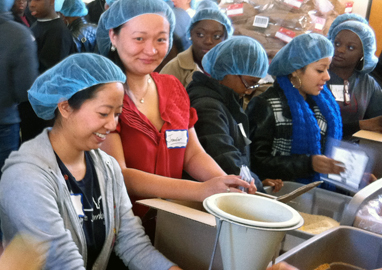 Volunteers in food packaging line