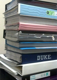 A picture of a stack of Fuqua coursepacks