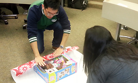 mba students wrapping gifts