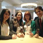 Latin American Students networking after corporate event.