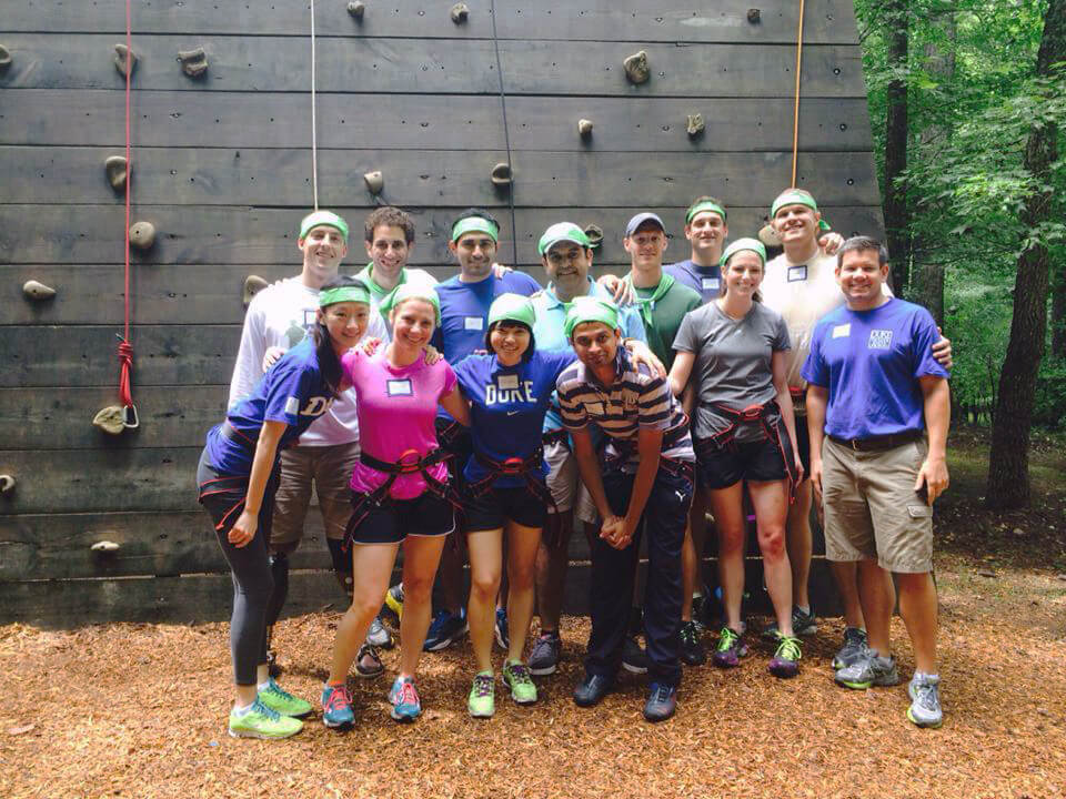 Our team was challenged to climb the wall at Triangle Training Center