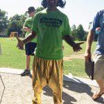 Student participate in the Deloitte kickball team