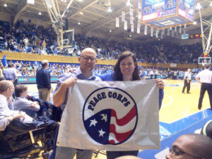 Returned Peace Corps Volunteers at a DUke basketball game - How Fuqua helps the transition from Peace Corps to an MBA