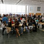 Hundreds of student gather for Fuqua Friday in The Fox Center, Fuqua's social hub