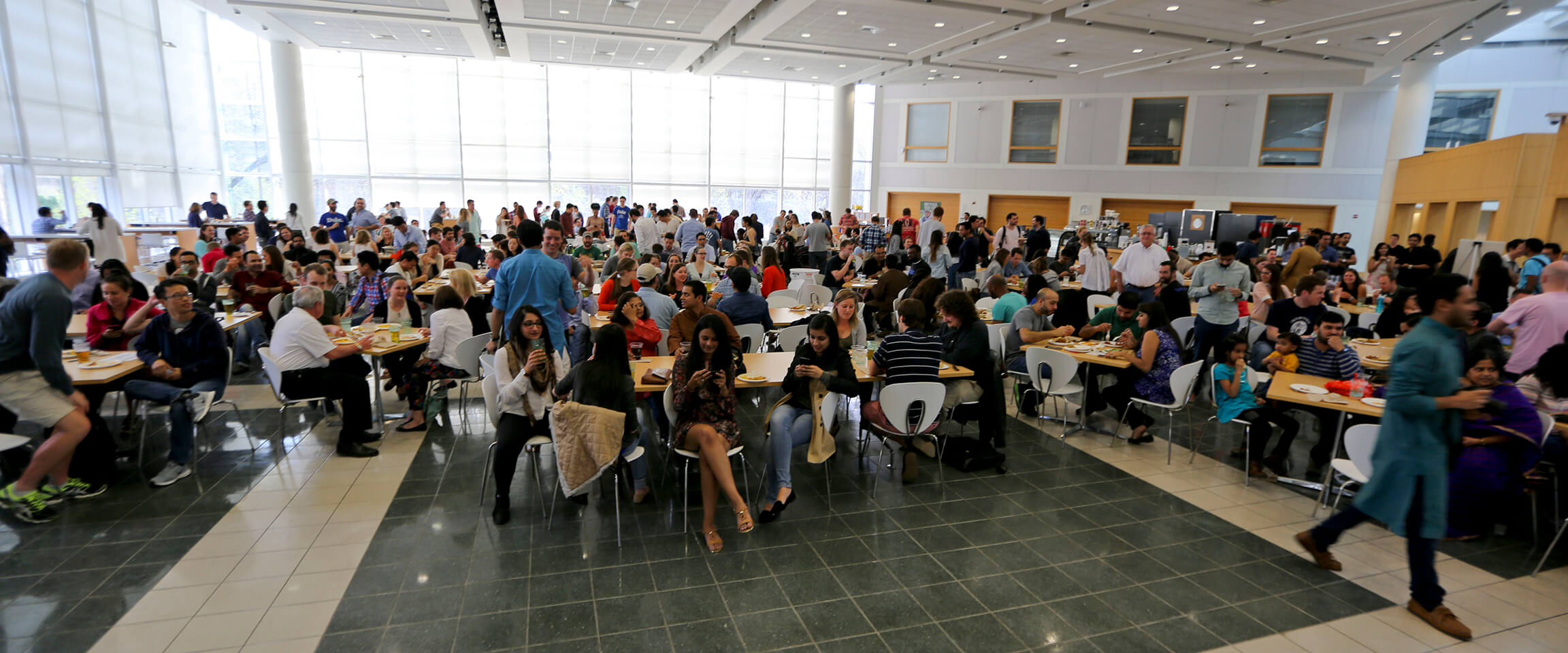 Hundreds of student gather for Fuqua Friday in The Fox Center, Fuqua's social hub