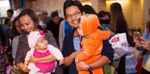 The author, her husband and their 2 kids including the kids who are dressed up for Halloween as part of a Fuqua Families Halloween event
