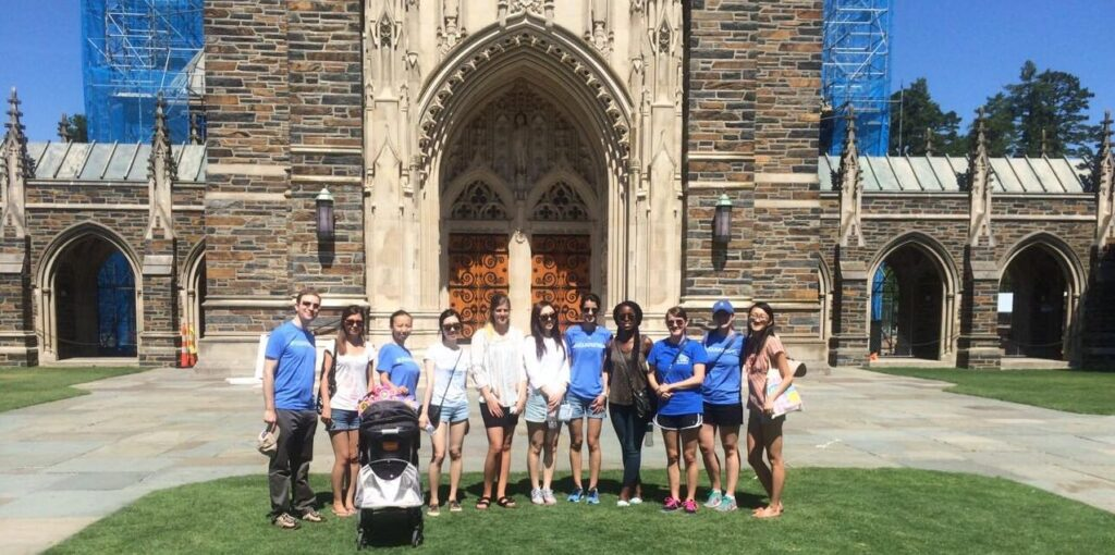 Members of the Fuqua Families group standing outside Duke Chapel