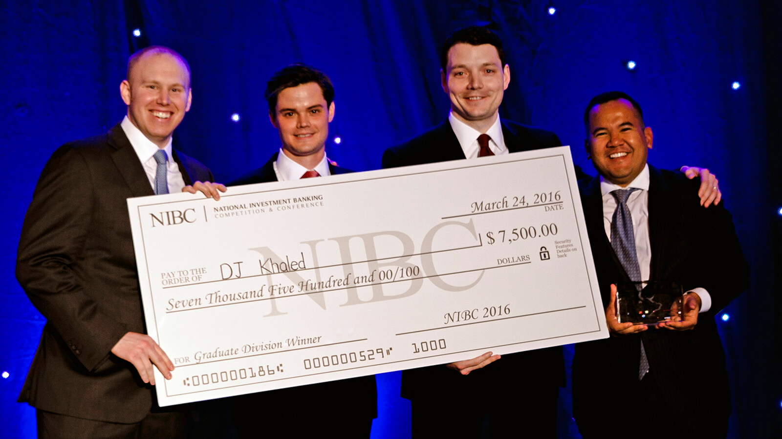 the 4 of us receiving our prize for winning the Investment Banking Competition