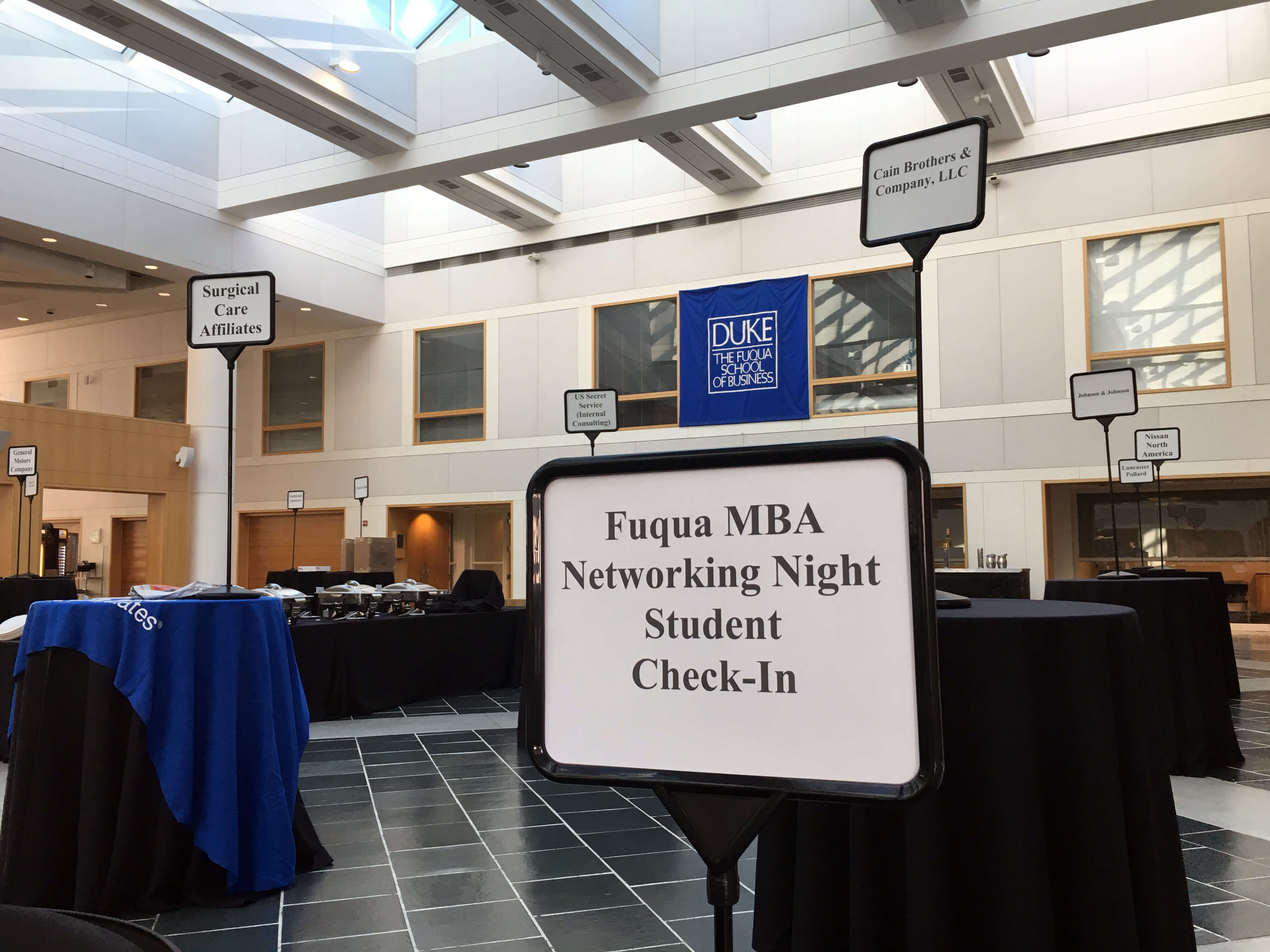investment banking firms among those listed on signs for a networking session in Fuqua's Fox Center