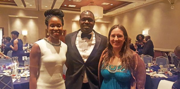 Three board members pose at the GDBCC Annual Gala to help Durham's small businesses