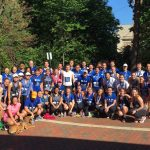About 60 Fuqua students pose for a group photo, staying fit