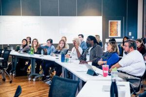 a judge providing feedback to participants on their social impact ideas