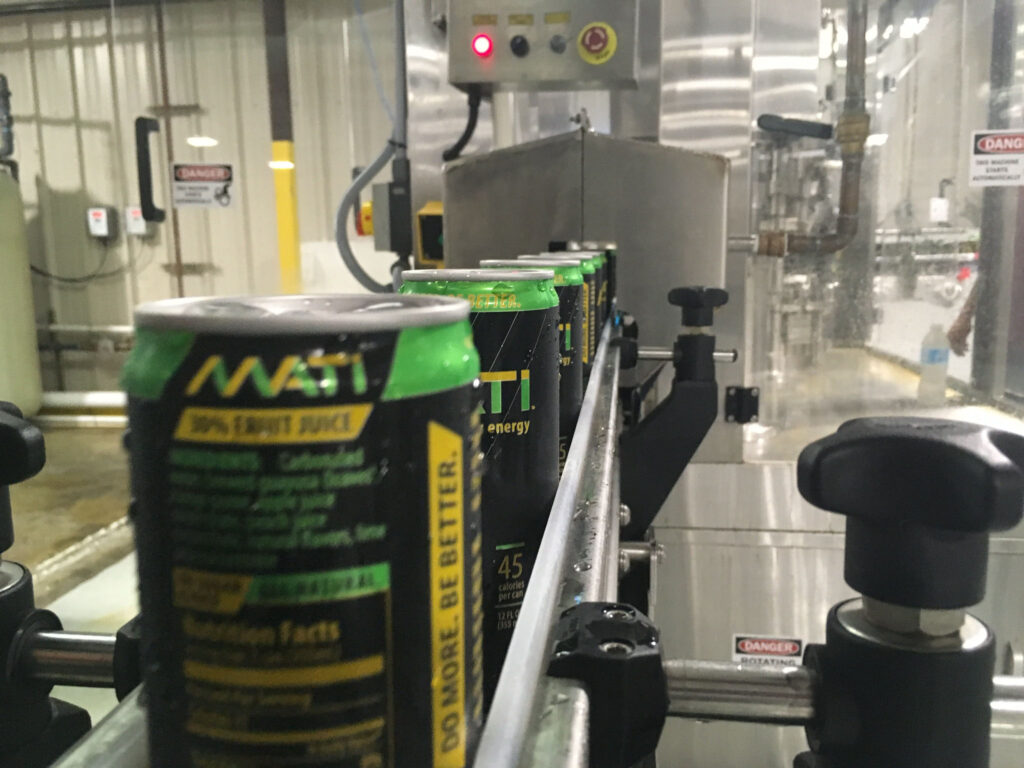 Mati cans on the brewery canning line, part of my mentored study experience