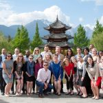 students posing in front of a Chinese landmark during the Global Academic Travel Experience
