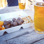 A pint of beer and snacks at Ponysaurus