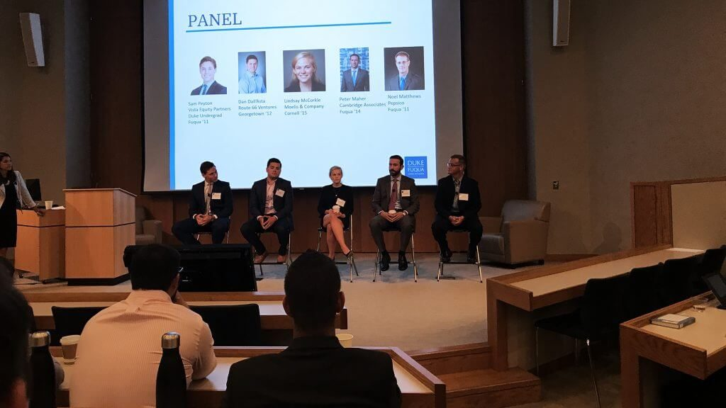 five panel members talk during a session at the finance career intensive
