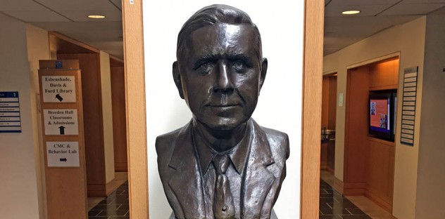 a bust of J.B. Fuqua in the school hallway