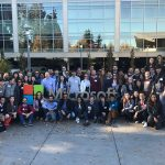 dozens of students on Tech Trek by Microsoft's sign