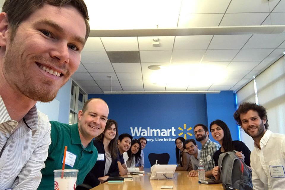 Students on Tech Trek sitting at a conference table at Walmart offices