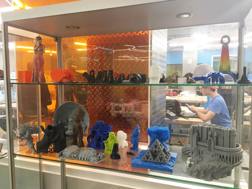 a display of figurines and other plastic models, a scene from exploring the Duke community beyond Fuqua