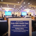a brochure and attendees from the conference, one of Fuqua's health care programming options