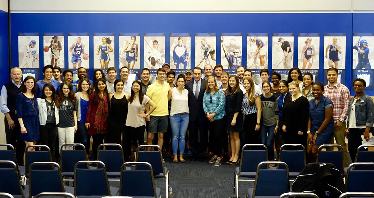 Coach K poses with a few dozen COLE fellows, one of our MBA student leader positions