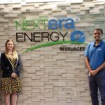 Jenna and her two EDGE classmates posing by NextEra Energy's office sign