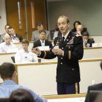 A uniformed Army officer address a classroom of veterans seeking veteran's perspective on The Duke MBA