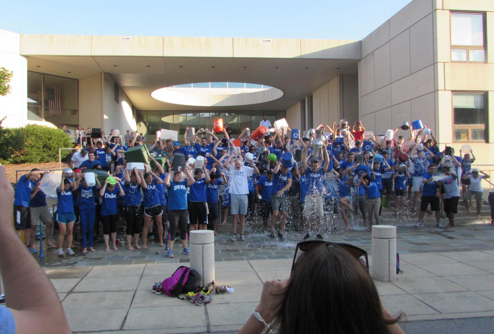 Dean Russ Morgan (center in white t-shirt) taking the ALS Ice Bucket Challenge with students