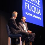 Duke Basketball Coach Mike Krzyzewski on stage talking with Fuqua Dean Bill Boulding, MBA recruiting