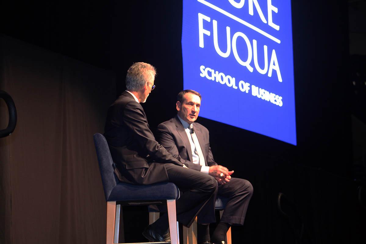 Duke Basketball Coach Mike Krzyzewski on stage talking with Fuqua Dean Bill Boulding, MBA recruiting