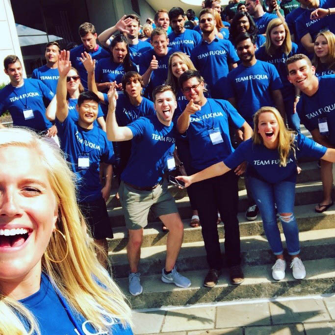 Class sections: section 5 posing for a selfie with McCallen on the Fuqua steps during orientation