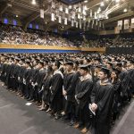 The entire class of 2018 Duke Fuqua MBA graduates standing during their commencement ceremony