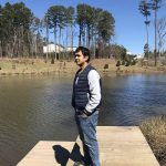Arpit Garg standing by the lake.