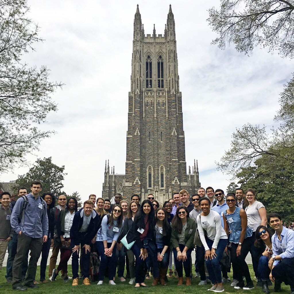 A couple dozen students pose for a photo in front of Duke Chapel