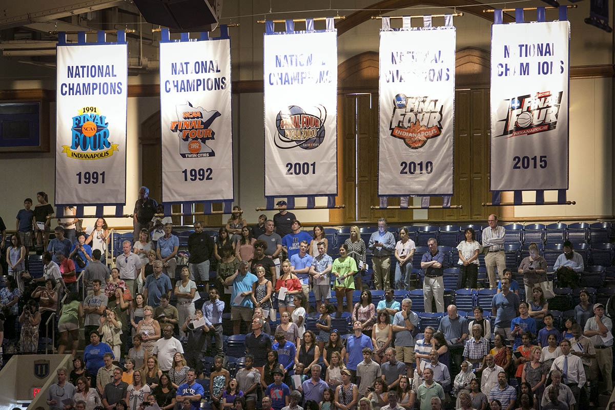 five Duke basketball national championship banners hanging in Cameron Indoor Stadium