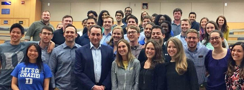 Coach K, Duke basketball head coach, poses for a group photo with 3 dozen Fuqua COLE fellows