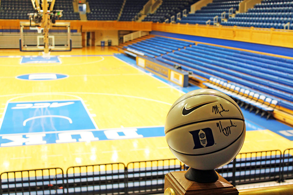 a Coach K autographed Duke basketball with the Cameron court in the background