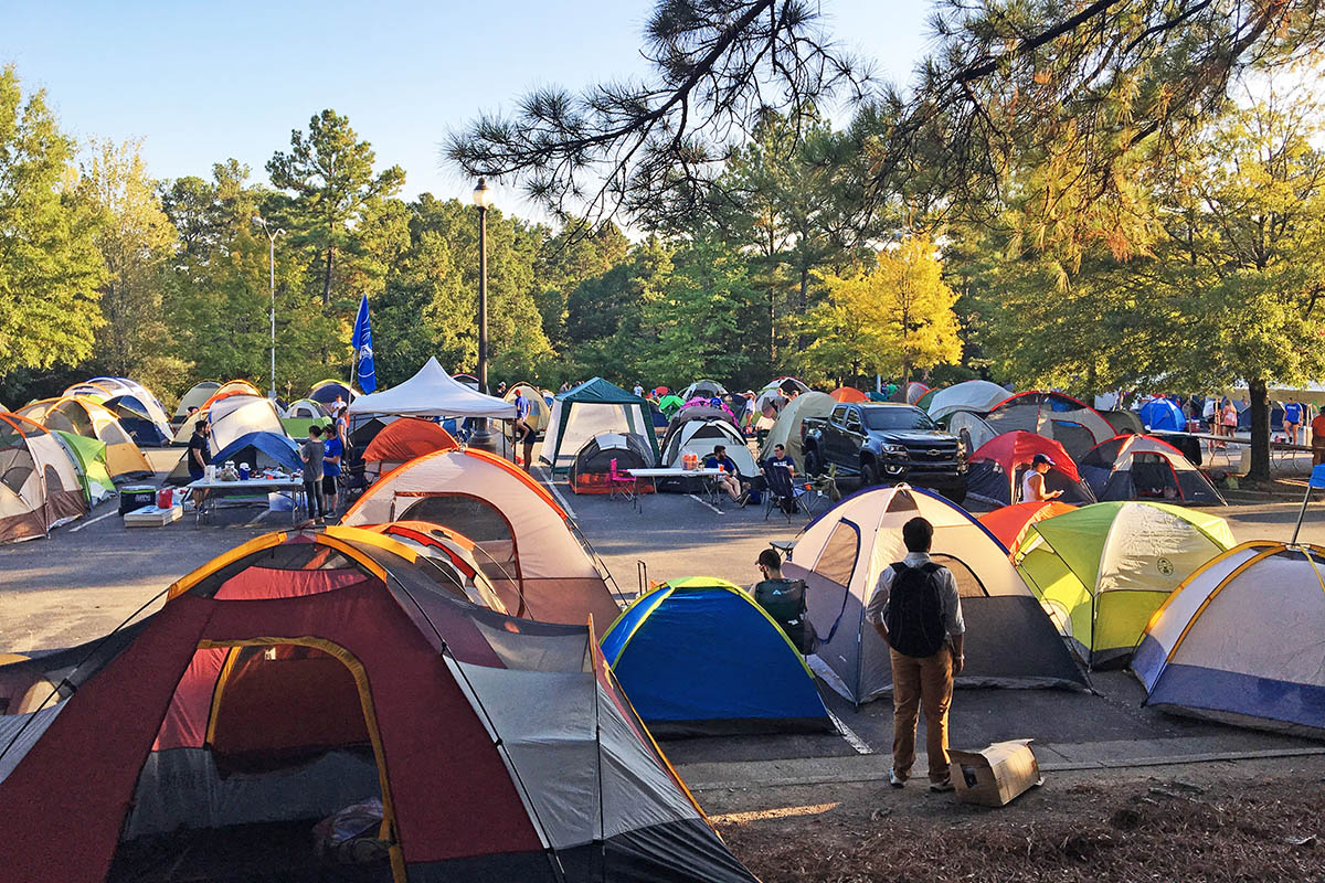 dozens of tents set up in a parking lot during the annual Campout event for Duke basketball tickets