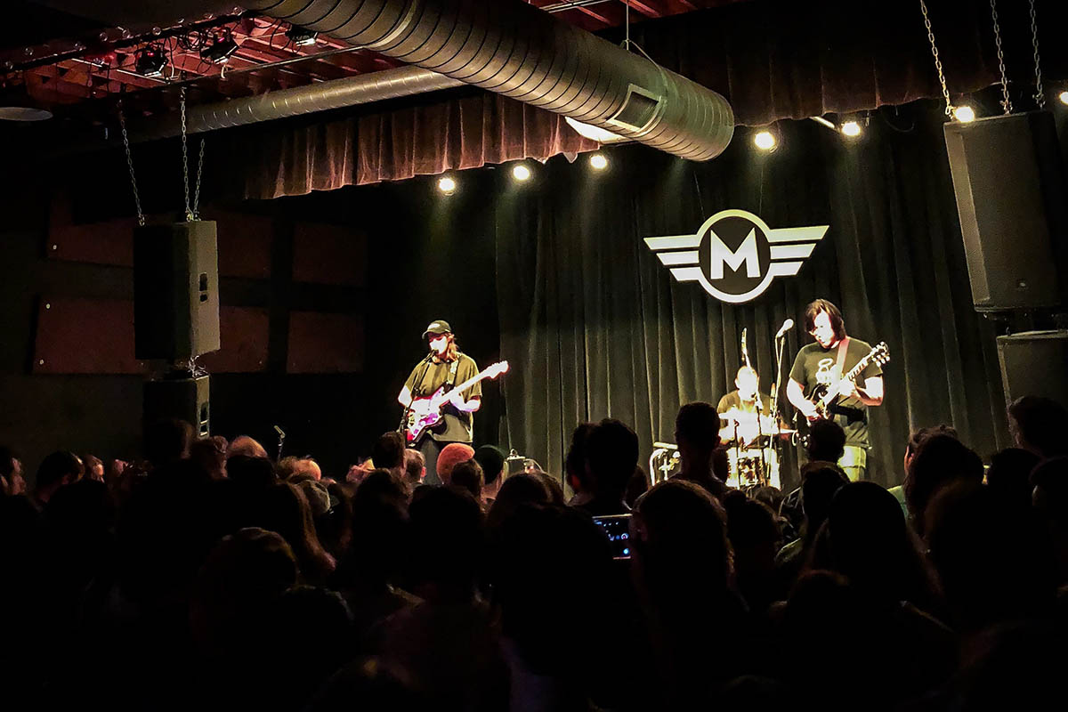 local music scene: a three-piece band performing at Motorco