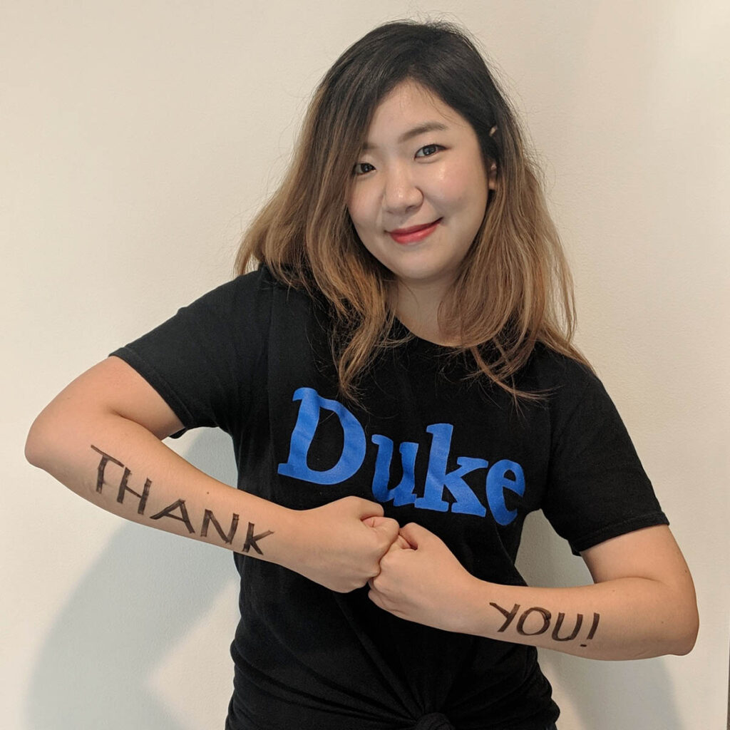 """Janette in a Duke shirt with """"thank you"""" written on her arms; gaining leadership experience"""
