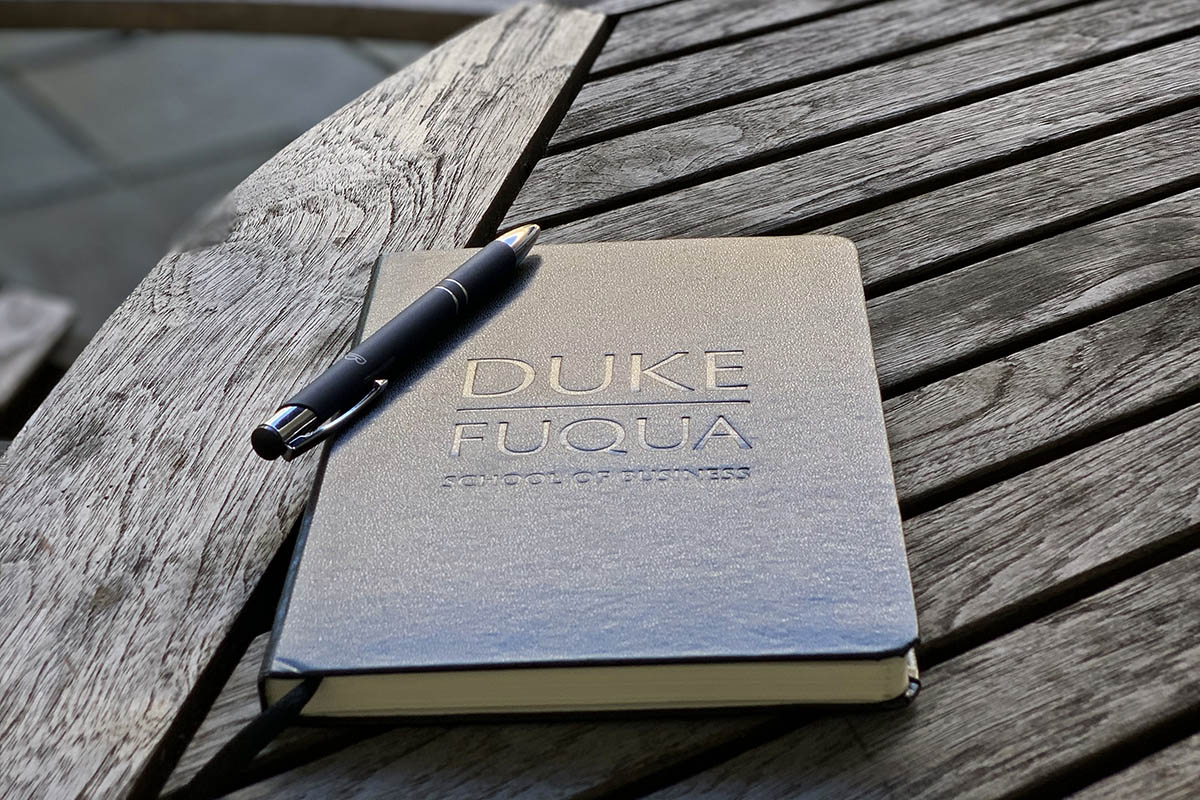 a Fuqua notebook on a table; gaining board experience