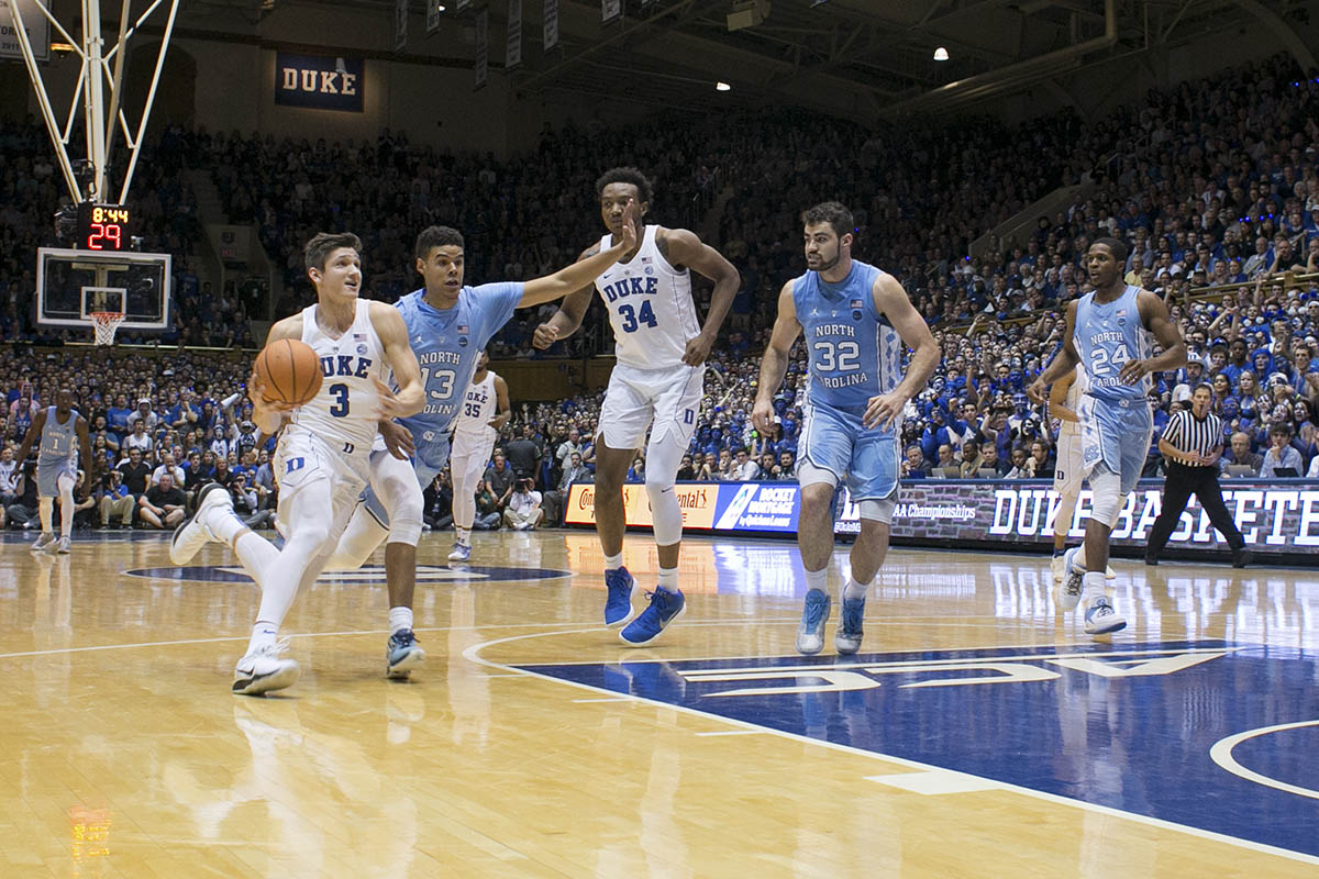 Duke's Grayson Allen dribbles toward the basket during a Duke-UNC rivalry game