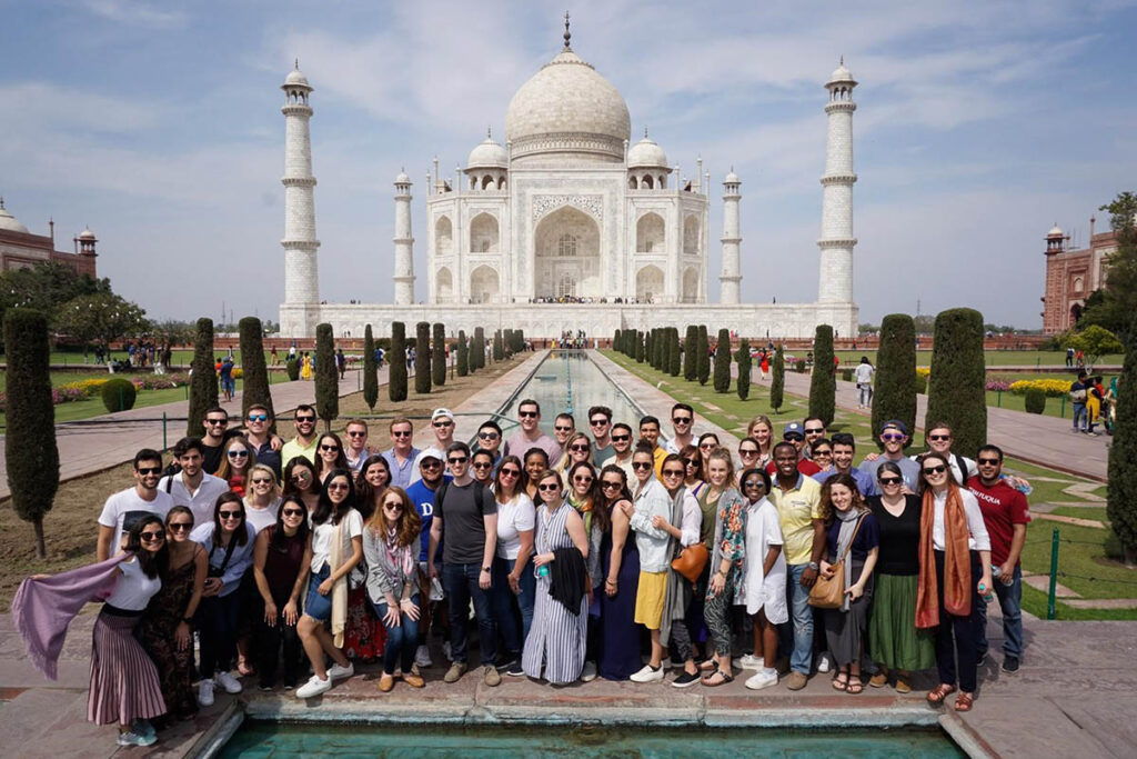 several dozen studetns posting in front of the Taj Mahal, one of Bishnu's most memorable experiences at Fuqua