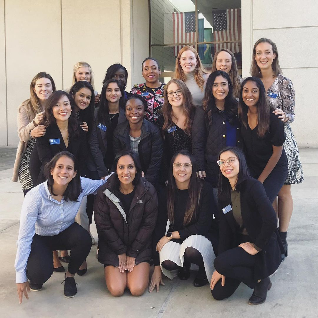 a dozen women students posing for a photo; Being a Woman at Fuqua
