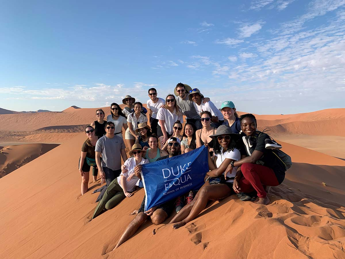 Nwaka Isamah with her classmates in the desert of Namibia; How My Multi-cultural Background Prepared Me to Attend Fuqua