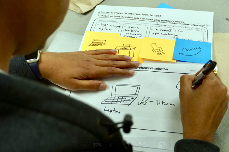 A student completing a worksheet during a Design + Innovation Club event