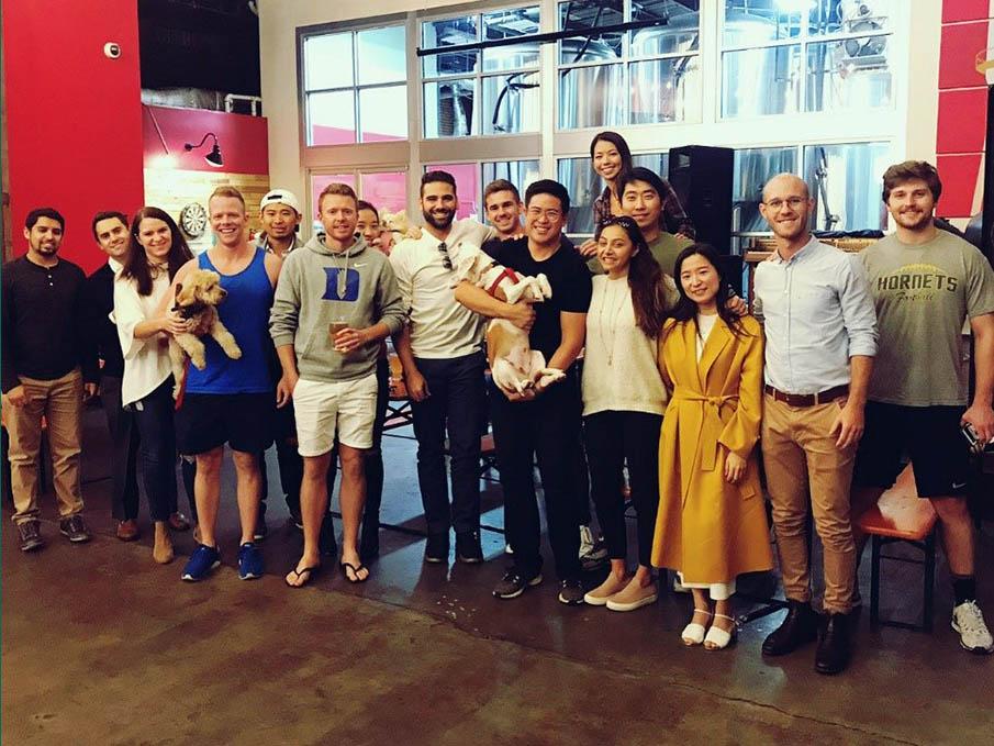 A dozen students posing for a photo; startups, venture capital, and entrepreneurship